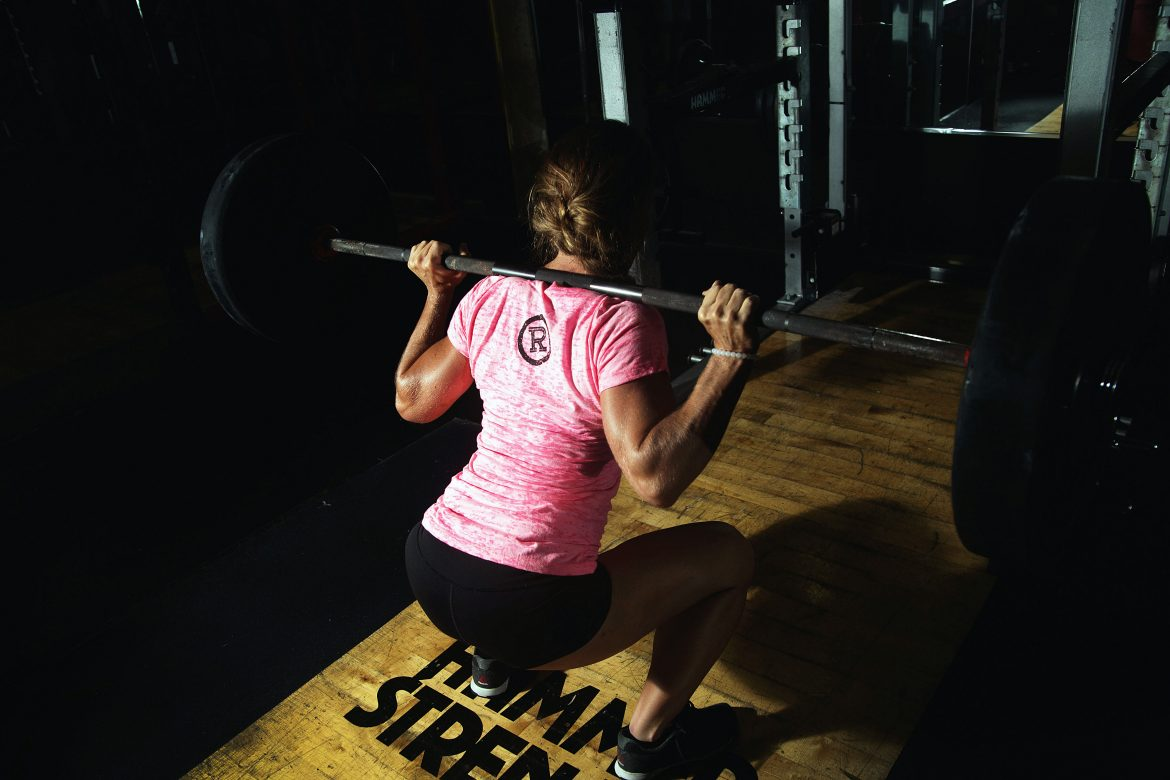 Woman Lifting Weight in Relentless Gear Fitness Apparel